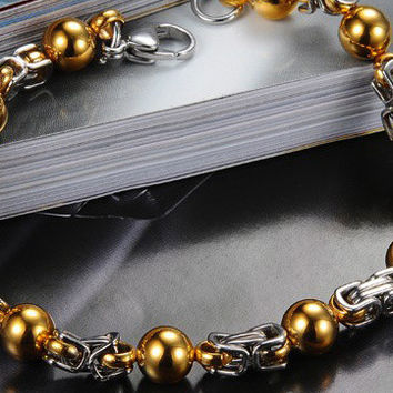 Stainless Steel Bracelet With Interval Gold Beads