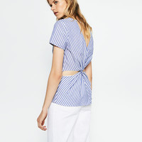 BLOUSE WITH KNOT AT THE BACK