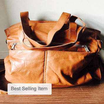 Large,soft and functional handbag. Our designer Envoyage bag. Full of compartments, flat handles and long strap makes a great computer bag.