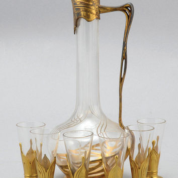 an art nouveau orivit gilt Liquor set including decanter and shot glasses