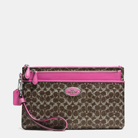 LARGEwristlet with pop-up pouchin signature coated canvas