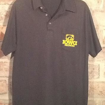 Vintage collectible Iowa Hawkeyes polo type black shirt. Size Large. Pocket on left br