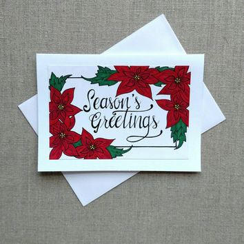Hand drawn and hand lettered 'Season's Greetings' holiday card, poinsettia Christmas card, blank holiday greeting card.
