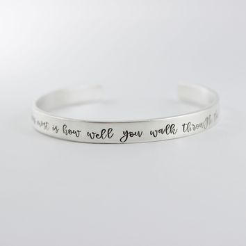 """""""What matters most is how well you walk through the fire"""" Cuff Bracelet"""