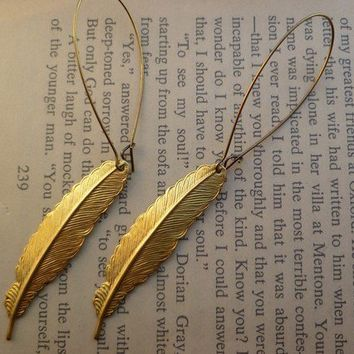 Feather earrings in gold by littlepancakes on Etsy