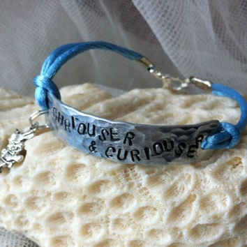 Stamped Alice in Wonderland themed aluminum charm bracelet - CURIOUSER & CURIOUSER