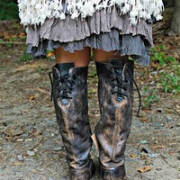 Real leather boots with a lace up and zipper.