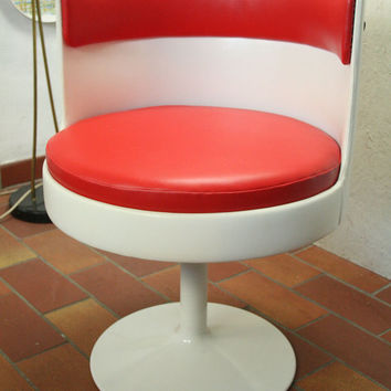 70s tulip footed swivel chair in red