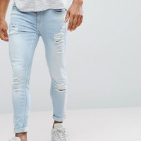 11 Degrees Muscle Fit Jeans In Blue With Distressing at asos.com