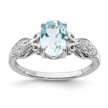 Sterling Silver Oval Sky Blue Topaz And White CZ Ring