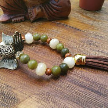 Earth Colors Green and Brown Charm Bracelet/Brass Elephant Charm/Brown Leather Tassel/Gold Hamsa Charm/Yellow Jade