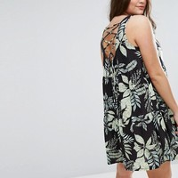 ASOS CURVE Sleeveless Smock Sundress With Lace Up Back in Palm Print at asos.com