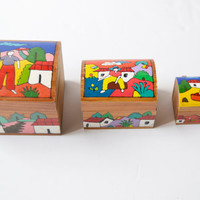 three boxes of hand-drawn wooden