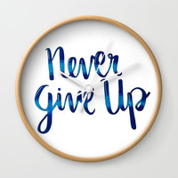 Never give up! Wall Clock by Jenna C.