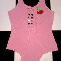 SWEET LORD O'MIGHTY! CHERRY LACE UP BODYSUIT IN PINK