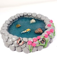 Miniature koi fish pond. Fairy garden accessories, dollhouse, terrarium décor. Pink flowers and butterflies.
