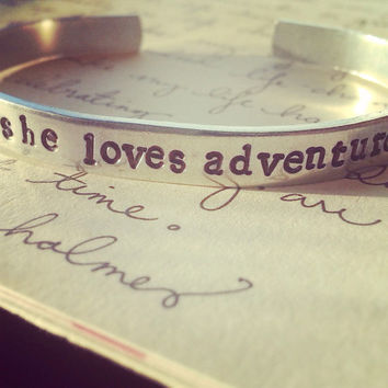 She loves adventure , hand stamped 1/4 wide aluminum bracelet, wanderer, adventurous