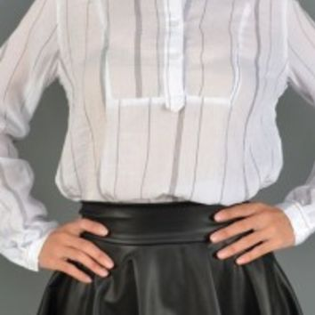 Low collar top featuring blue stripe pattern, three button closure scoop necklace, long sleeves with single button closure, high low construction. Pair with leather skater skirt, tight high socks, and knee high boots.
