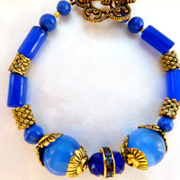 Winter Bridal Bright Ultramarine blue bracelet Cat's eyes bracelet Egyptian inspired Gold metal Findings Rhinestone details Czech crystals
