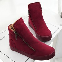 Plush ankle boots with side zippers
