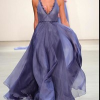 Gorgeous deep periwinkle silk organza gown. Structured V neck bodice with hand sewn embellished details from lass