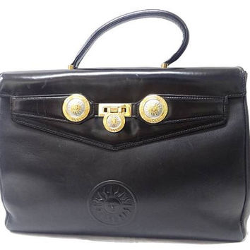 Vintage Gianni Versace genuine black leather Kelly style bag with Medallion Sunburst charms . Gorgeous masterpiece