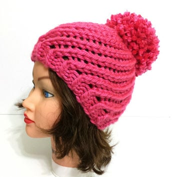 Adorable chunky hat, knitting cute beanie decorated with pompom.