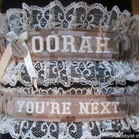 US Marine set with OORAH embroidered on it in desert camo fabric and throw garter that's says You're next