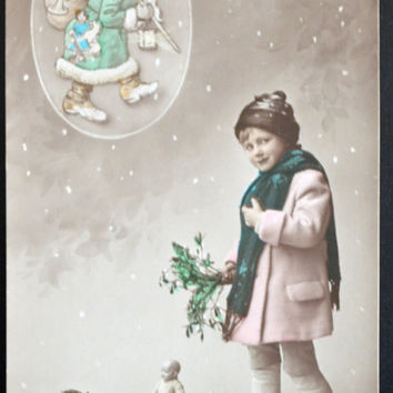 Hand Tinted RPPC Postcard Santa Claus and Child with Toys