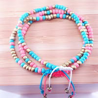 """Seed Bead Bracelet in Turquoise // coral and matte gold accents // white nylon cord // """"Pura Vida"""" inspired // adjustable slip knot"""