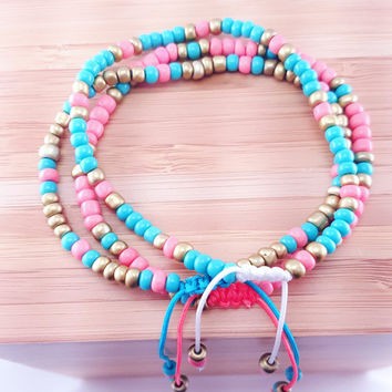 "Seed Bead Bracelet in Turquoise // coral and matte gold accents // white nylon cord // ""Pura Vida"" inspired // adjustable slip knot"