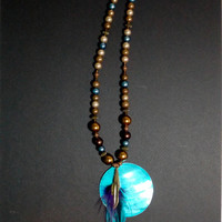 Handmade Earth tone, Bronze, and Turquoise Feather and Pendant Necklace from NotionsN'Potions