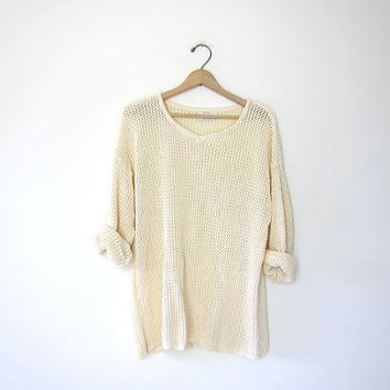 vintage slouchy knit crochet sweater. open knit oversized top. semi sheer long sleeve sweater. cut out shirt. loose knit pale yellow mesh