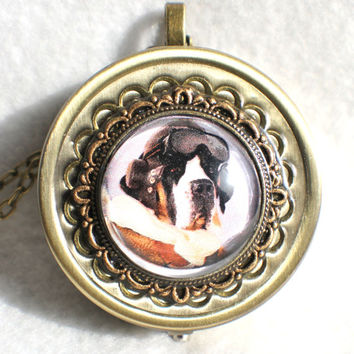 Music box locket,  round locket with music box inside, in bronze with steampunk dog cabochon on front cover.