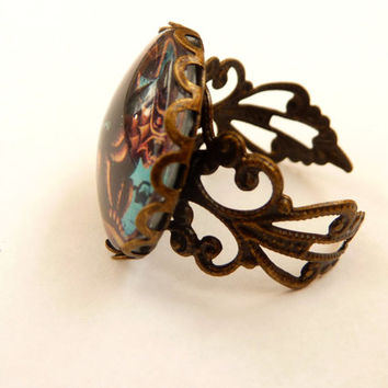 Gothic ring in bronze with winged demon, squiggly ring