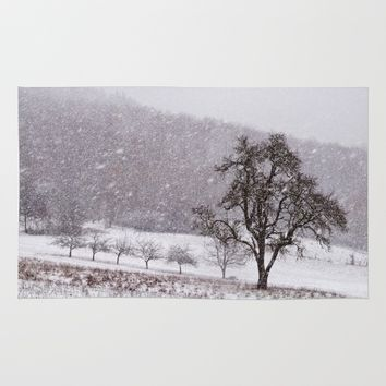 Old pear tree on a wintery meadow Rug by Pirmin Nohr