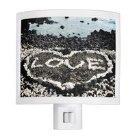 Hawaii black sand beach coral heart close-up photo night light