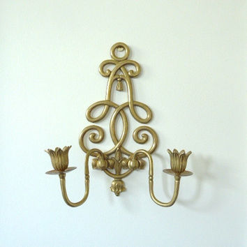 Andrea by Sadek brass scroll and tassel candle sconce