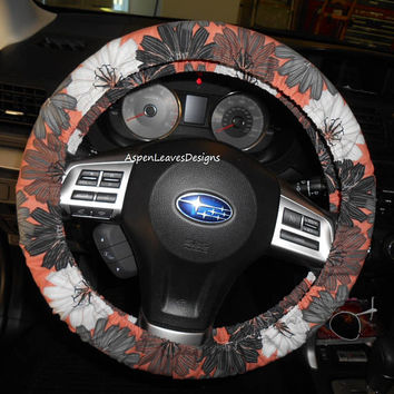 Steering wheel cover with large modern flowers on coral fabric. Gray white, black and coral car decoration.