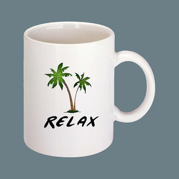 Ceramic Coffee Mug with Palm Trees and says Relax. Nothing better than waking up by the beach with a hot cup of java.
