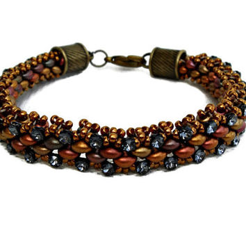 Gold and brown beaded bracelet with Swarovski elements. Seed beads jewelry