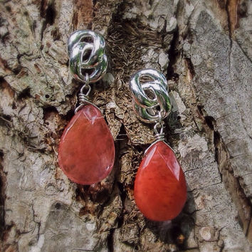 Antique, silver tone, knot earring with coral color, stone teardrop briolette.