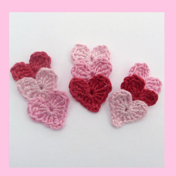 9 small crochet hearts, appliques and embellishments