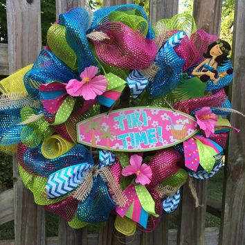 Tiki Time deco mesh wreath, green, bright pink, and blue deco mesh wreath with pink hibiscus flowers and hula girl