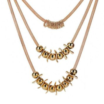 Gold Bead Triple Necklace