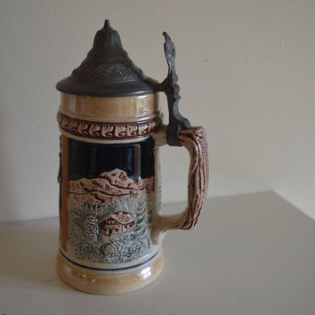 Vintage Beer stein/pottery stein made in West Germany/raised relief moulded design pewter hinged lid/ships worldwide from UK