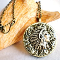 Music box locket, round locket with music box inside, in bronze with American Indian Chief and bronze filigree on front cover.