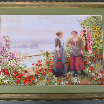 Handmade satin ribbon embroidery with flowers and girls in frame on canvas