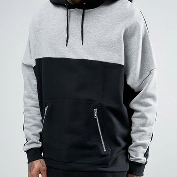 ASOS Extreme Oversized Longline Hoodie With Cut & Sew Panels & Zip Pockets at asos.com