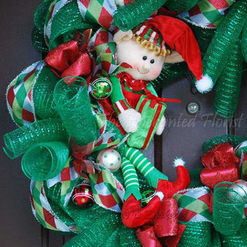 Christmas Wreath - Christmas Elf.  Red Green, and White Deco Mesh Wreath.  Elf sitting on a wreath!